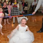 Girl limbo at her Kids Playing Limbo at a Communion in NJ