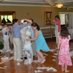 Kids Playing Mummy Wrap Game at a Communion in NJ